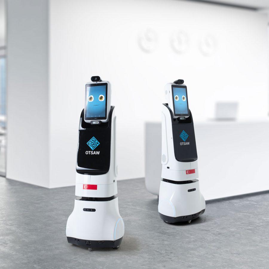 Multipurpose AI robots in a modern office