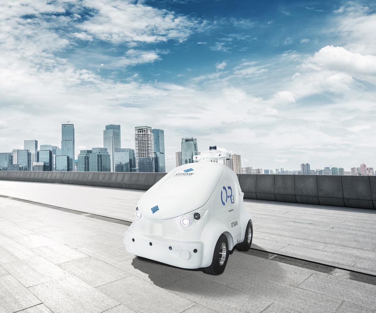 OTSAW O-R3 security robot against a city background